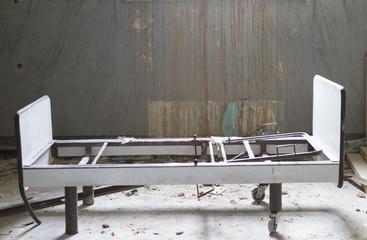 abandoned hospital bed