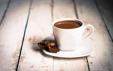 Cup of hot chocolate on wooden background