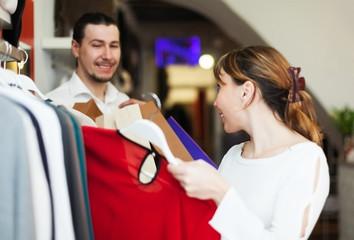 Man and woman choosing clothes at store