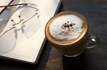 time to relax with coffee, a cup of coffee in clear glass next t