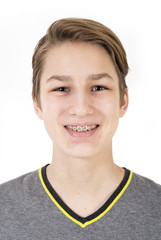 Smiling teen with orthodontic braces