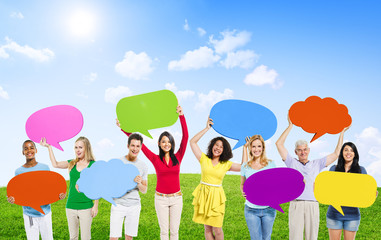 Multi-Ethnic People Holding Speech Bubbles Outdoors