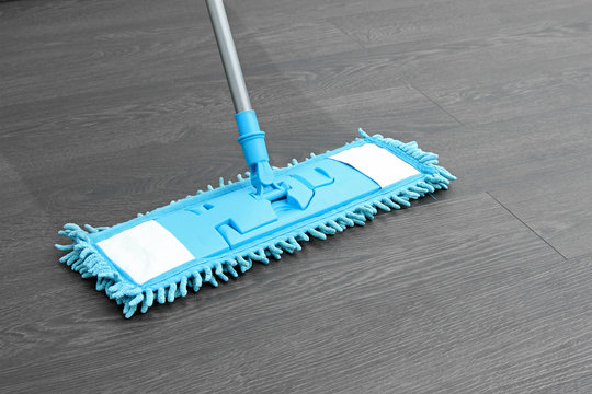 house cleaning - mop washing wooden floor