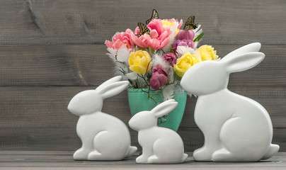 Easter bunnies with tulips flowers