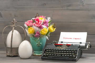 Easter still life with tulips, eggs and typewriter