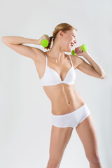Cute Girl athlete on a white background