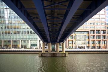 LONDON, CANARY WHARF UK - APRIL 13, 2014 - DLR bridge