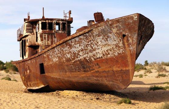 Boats in desert around Moynaq - Aral sea - Uzbekistan