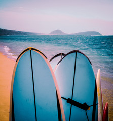 Retro Surfboards On Beach