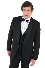 Confident groom in tuxedo