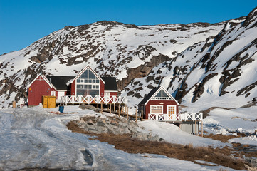 Wooden house, with snowy mountain in Ilulissat, Greenland