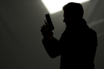man killer policeman aiming gun - fototapety na wymiar