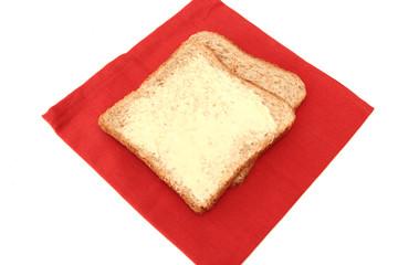 tranche de pain beurée