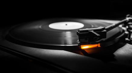 old style turntable with needle - b&w and orange light