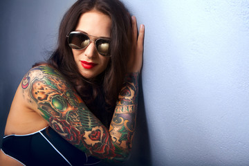 Beautiful girl with stylish make-up and tattooed arms,,