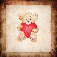 teddy bear holding red heart