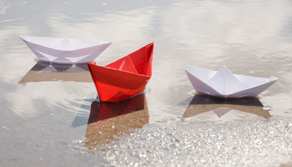 colored paper boats in water
