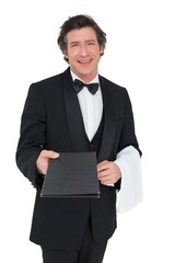 Confident waiter giving bill pad over white background