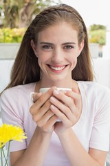 Beautiful woman drinking coffee at café