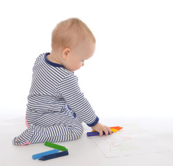 Child baby toddler sitting drawing painting with colour pencils