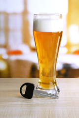 Composition with car key and glass of beer,