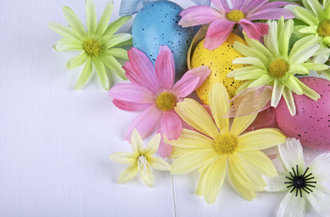 Flowers and eggs on light background