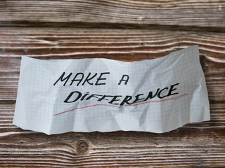 """word"""" make a difference """"  on torn paper"""