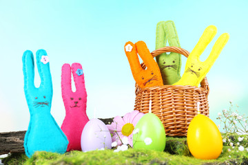 Composition with funny handmade Easter rabbits