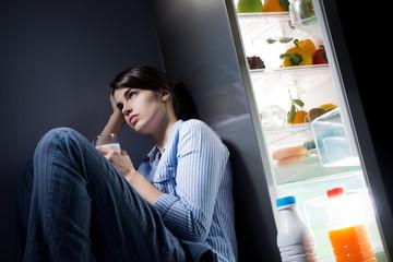 Sleepless woman having a glass of milk