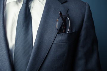 Businessman with glasses in pocket