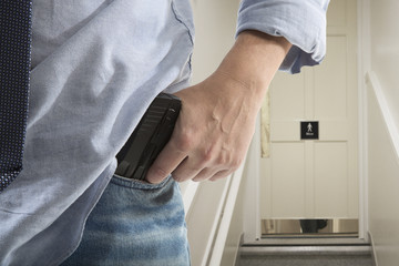 Bodyguard with gun protects client