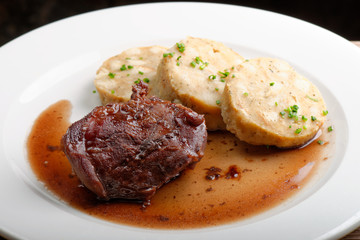 Veal fillet with rich sauce and dumplings - traditional Czech