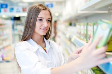 portrait of beautiful blonde female pharmacist