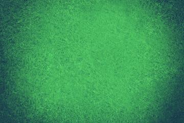 Green poker table felt background. Toned image