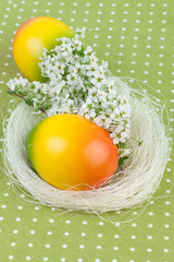 Easter Nest Decoration on Green Polka Dot Tablecloth