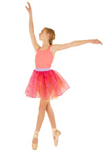 Cute young ballerina in fourth position on pointe