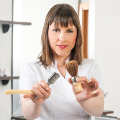 a hairdresser showing their tools in the barbershop