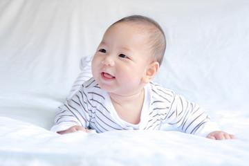 Smiling Baby on Light Blue Blanket