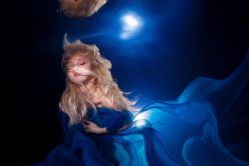underwater photo pretty young girl  with blond long hair wearing