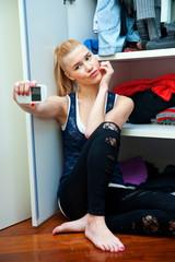 teen girl making selfie in her room