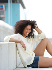 Young woman smiling and relaxing outdoors