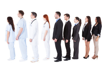 Doctors and managers standing in queue