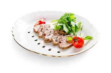 roast beef with lettuce on white background