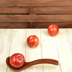 Red apples and tea cup with tea bags