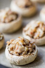 Mushroom champignons stuffed with filling of chicken, cheese