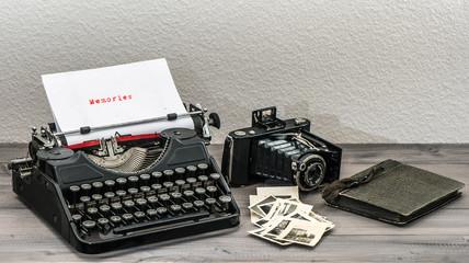retro typewriter and vintage photo camera