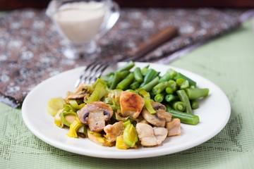 Chicken fillet fried with leek, mushrooms, green beans, cream