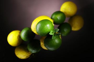 Lemons and limes on dark background