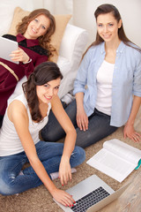 three young girls with a laptop