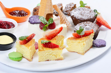 Plate of different desserts isolated